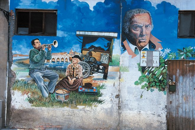 "Murals commemorate Fellini, Rimini<br /><a href=""http://static.riviera.rimini.it/tl_files/gallerie/orig/murales.jpg.zip"" target=""_blank"" class=""photo-download"">Download high resolution image</a>"