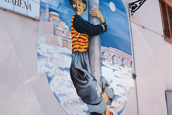 "Murals commemorate Fellini, Rimini<br /><a href=""http://static.riviera.rimini.it/tl_files/gallerie/orig/murales_fellini.jpg.zip"" target=""_blank"" class=""photo-download"">Download high resolution image</a>"